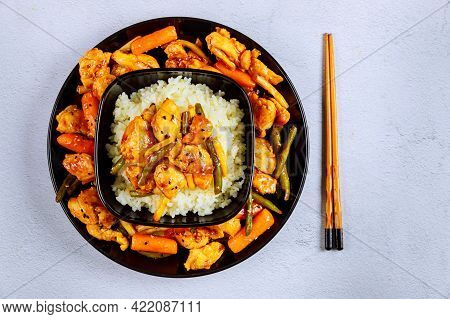 Asian Stir Fry Meat, Vegetables With White Rice And Chopstick.