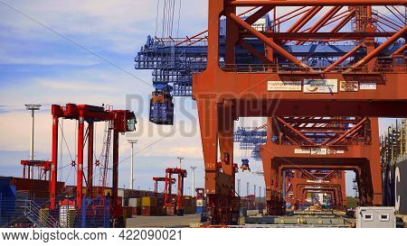 Container Terminal In The Port Of Hamburg - Hamburg, Germany - May 10, 2021