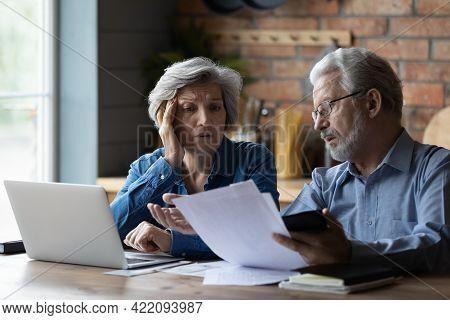 Concerned Elderly Couple Discuss Unpaid Bank Debt