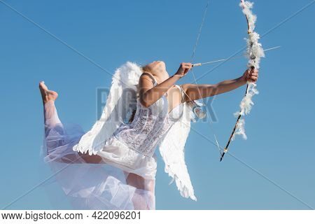 Sexy Sensual Angel With Bow And Arrow. Cupid Girl In White Dress. Portrait Of Sweet Angelic Girl. Ha