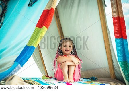 Kids Camping. Having Fun Outdoors. Campground. Little Girl With Tent On Camp. Boho Kids Style. Smili