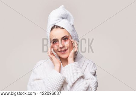 Woman Applying Eye Patches. Close Up Portrait Girl With Towel On Head. Portrait Of Beauty Woman With
