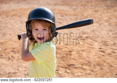 Child Baseball Player Focused Ready To Bat. Kid Holding A Baseball Bat.
