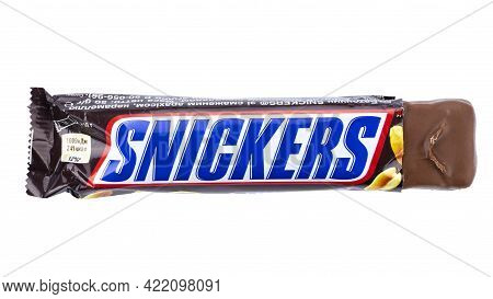 Ukraine, Kyiv - November 30. 2020:  Snickers Chocolate Bar Isolated On White Background. Snickers Is
