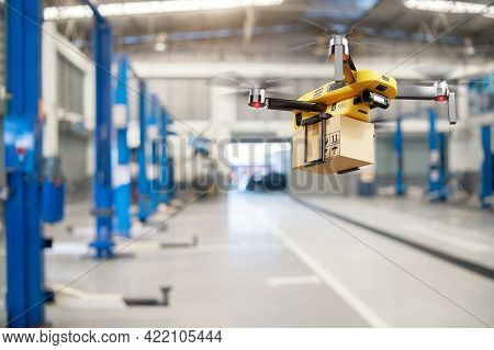 Flying Delivery Drone Transferring Parcel Box From Distribution Warehouse To Automotive Garage Custo