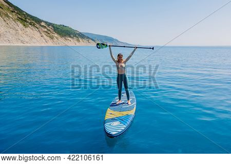 May 15, 2021. Anapa, Russia. Sporty Woman On Stand Up Paddle Board At Blue Sea. Surfer Woman Walking