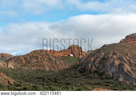 Vensterkop, A Hole In The Mountain At Red Stone Hills In The Western Cape Karoo. A Second Hole Is Vi