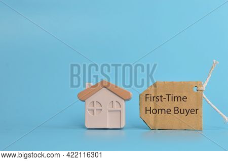 Toy House And Label Tag Written With First-time Home Buyer.