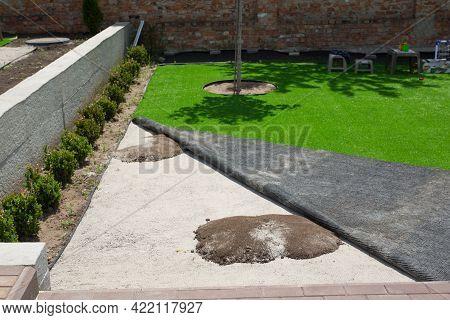 Mole Hills Under Artificial Turf In Garden. Grass Damage Concept.