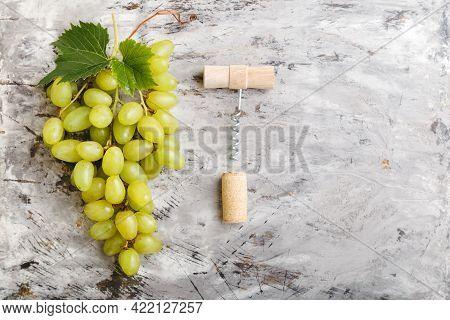 Large Ripe Green Riesling Grape Grone Corkscrew And Wine Cork Stopper. Ripe Juicy Green Grapes On Li