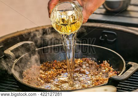 Chef Prepares Ingredients For Bulgur On The Grill. Close Up