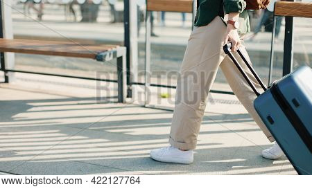 Close Up Of Suitcase, Woman Walking With Suitcase On Street In City Outdoors And Meeting Male Friend