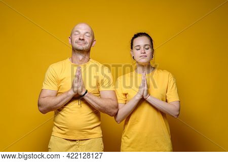 Man And Woman Folded Their Palms In Supplication And Hope For The Fulfillment Of Their Dreams, Close