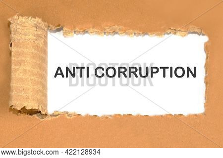 Anti-corruption Text On Torn Cardboard On A White Background.