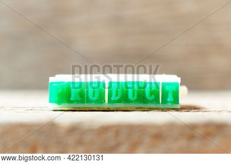 Green Color Rubber Stamp In Word Product On Wood Background