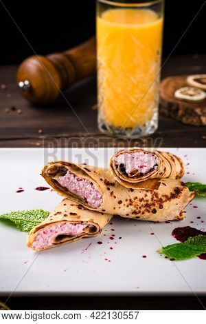 Crepes Filled With Cottage Cheese And Orange Juice For Breakfast