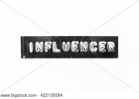Embossed Letter With Word Influencer In Black Banner On White Paper Background