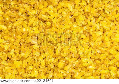 Food Background - Uncooked Bulgur Wheat Groats