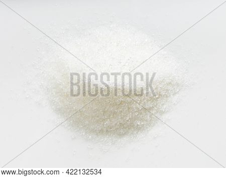 Top View Of Pile Of White Refined Beet Sugar Close Up On Gray Ceramic Plate