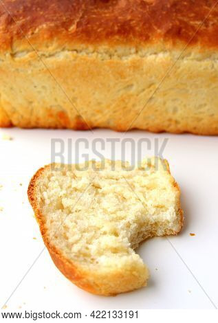 Homemade White Wheat Bread With A Crispy Crust. Baking With Hand-kneaded Yeast Dough. Bite Off A Pie