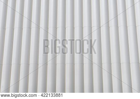 Circular Metal Structure Made Of Several White Tubes As A Cladding For An Outer Wall Of An External