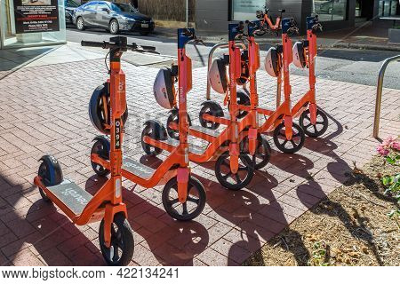 Adelaide, South Australia - April 4, 2021: Neuron E-scooters Parked In Adelaide City Centre Ready To