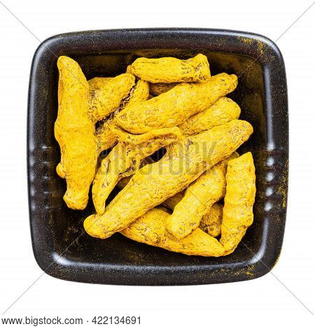 Top View Of Turmeric (curcuma) Roots In Black Bowl Isolated On White Background