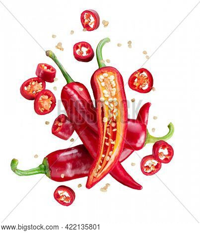 Fresh red chilli peppers and cross sections of chilli pepper with seeds floating in the air. File contains clipping paths.
