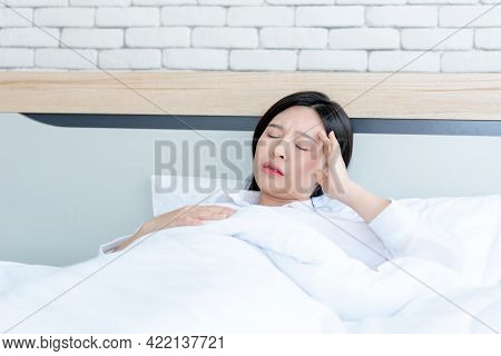 Portrait Images, Asian Attractive Woman 25 Year Old, Lying In Bed And Having Headache, Onset Of Flu