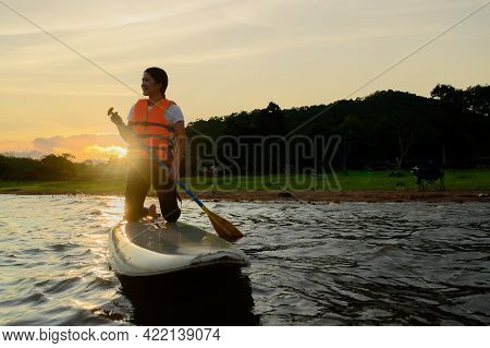 Asian Athletic Woman On Stand Paddle Board In Lake. Solo Outdoor Sup Activity And Water Sport On Sum