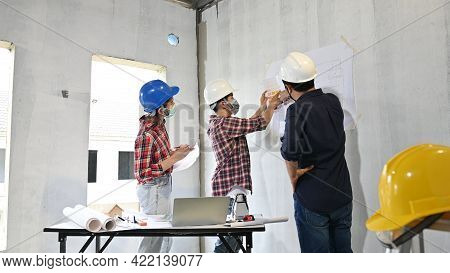 Engineer Team Discuss And Working At Construction Property Site. Owner Inspection At Village Project