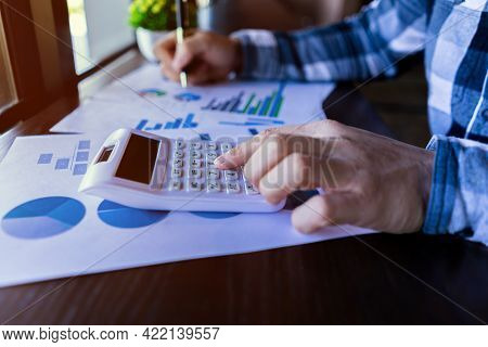 Businessman Using A Calculator To Working In Finance And Accounting Analyze Financial Budget In The