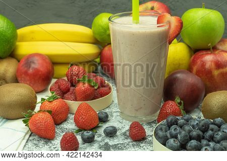 A Glass Of Cool Milkshake With Fruit. A Glass Of Milkshake With Berries. Background With Space For T