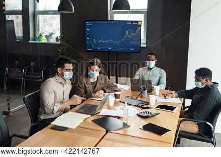 Colleagues Having Meeting In Boardroom, Working On New Project