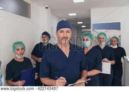 orthopedic doctor working together with his multiethnic team