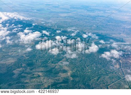 Aerial View From Airplane Window Above Grenn Ground. View From The Airplane Window With Beautiful Cl