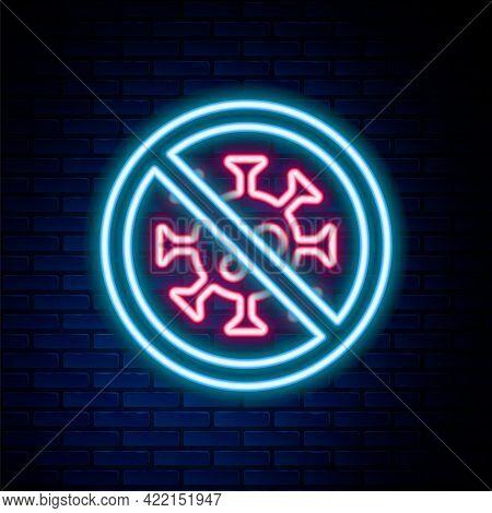Glowing Neon Line Stop Virus Icon Isolated On Brick Wall Background. Corona Virus 2019-ncov. Bacteri
