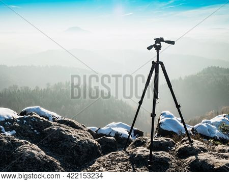 Empty Tripod Ready For Creating Time Lapse In Mountain Winter Landscape. Frozen Morning Outdoor