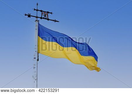 Flag Of Ukraine On A Blue Sky Background. Ukraine Flag Silk Waving Flag Of Ukraine Made Transparent