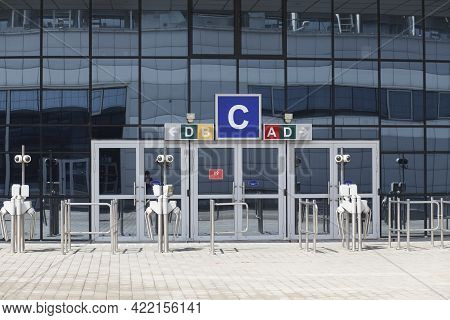 Glass Doors And Turnstiles, Entrance To The Indoor Stadium Arena, Airport. No People Or Visitors. Te