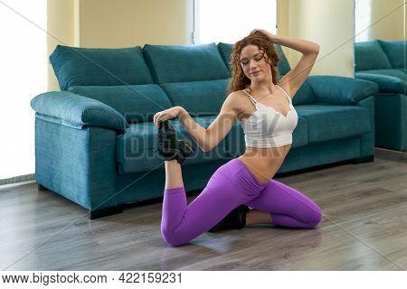 Beautiful Woman Exercising At Home And Keeping Fit. Portrait Of A Young Woman Exercising At Home. Sh