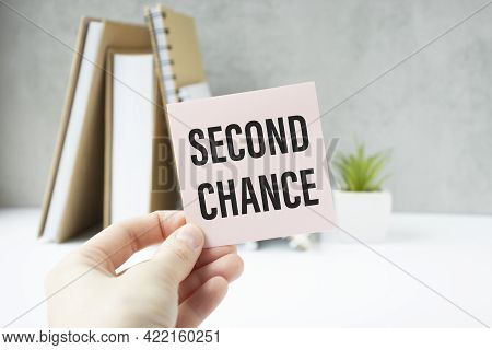 Businessman Holding A Card With Text Second Chance