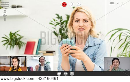 Videoconferencing With Colleagues On Computer, Laptop Monitor With Video Conferencing Of People
