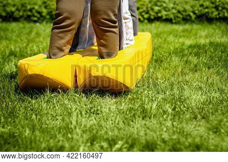 Teambuilding Exercises With Fun Ski On The Grass. Concept Of Summer Team Building With Copy Space
