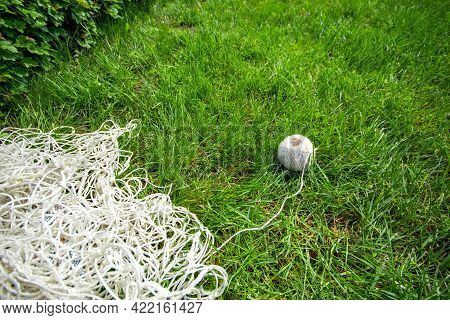 Roll Of White Rope In Green Grass Or Lawn