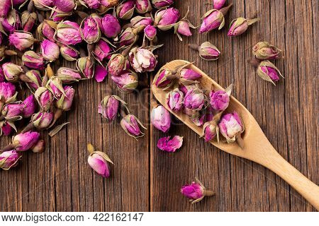 Dried Rose Flowers. Dried Roses. Rosebuds For Decoctions. Dried Rosebuds On The Table Close-up. Lots