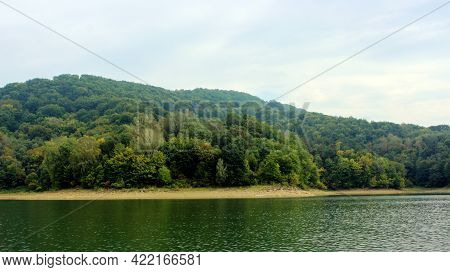 Looking At The Surface Of A Large And Beautiful Mountain Lake