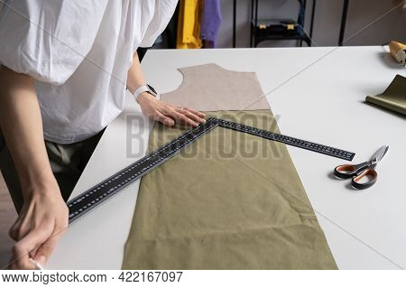 Tailor Couturier Measuring Fabric. Closeup Of Professional Sewer Female Use Triangle Ruler To Cut Ma