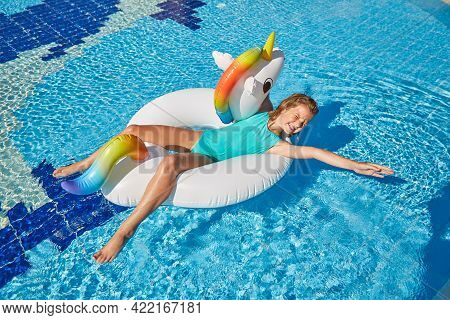 Woman In An Inflatable Circle In The Form Of A Unicorn, Playing On The Water.