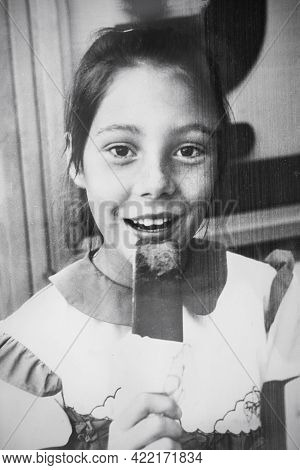 Retro Portrait Of A Soviet Girl With Ice Cream Popsicle. Vintage Black And White Paper Photo. Early